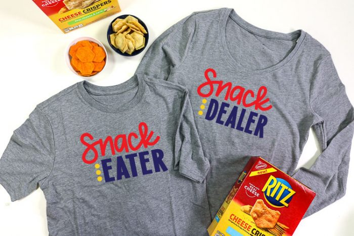 2 Grey shirts, adult shirt has Snack Dealer adn child shirt has snack eater in iron on vinyl - horizontal layout