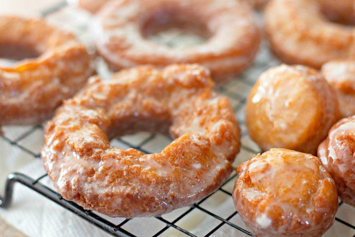 Close up of pumpkin donuts and pumpkin donut holes