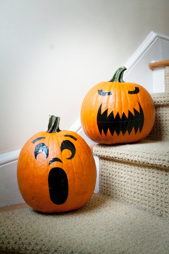 Pumpkins with faces added by using contact paper