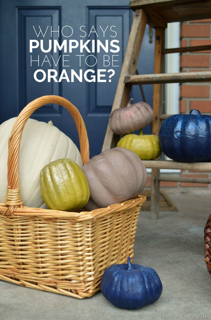 pumpkins on a porch that have been spraypainted non traditional solid colors