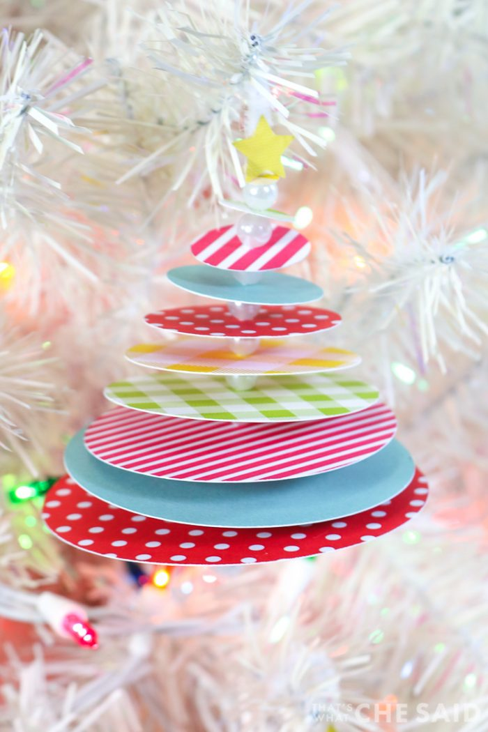 STacked circle tree ornament hanging on white christmas tree