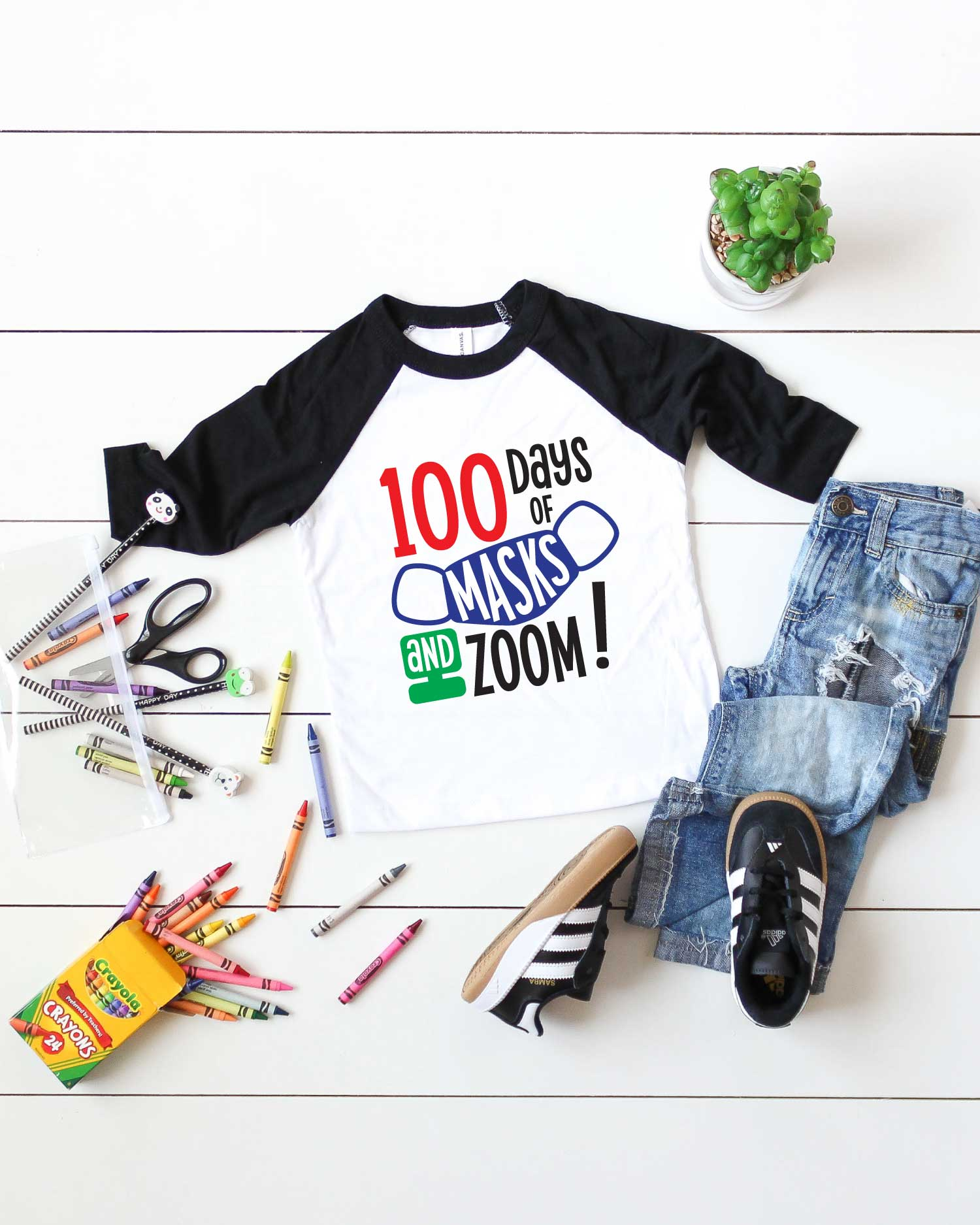 Vertical White background with black and white raglan t-shirt with 100 days of school design and school supplies