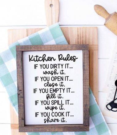White wood with Cutting Board, kitchen towel, rolling pin and sign that has kitchen rules svg applied