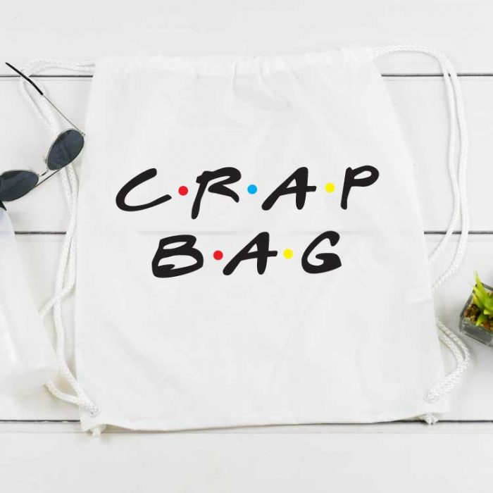 """White draw string back pack with """"Crap Bag"""" written in the FRIENDS tv show font applied with sublimation"""