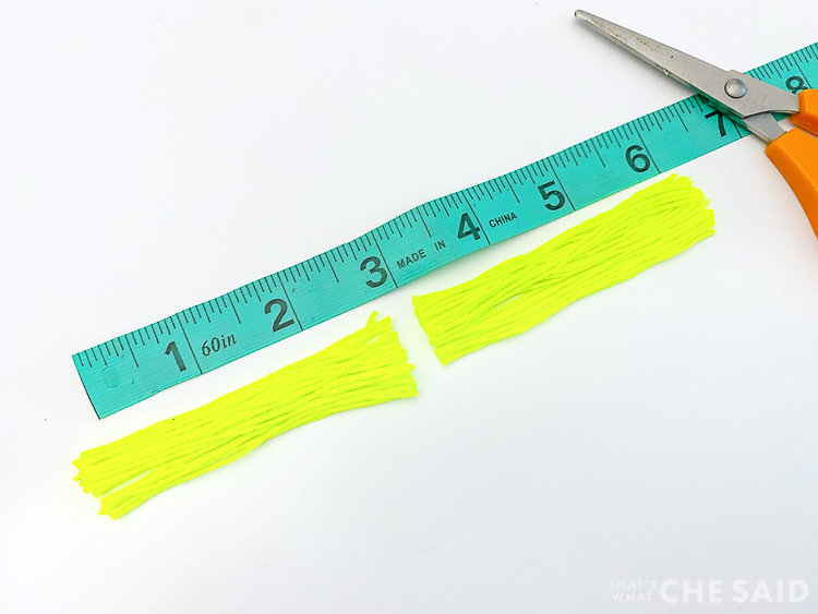 Measuring tape with embroidery thread cut in half