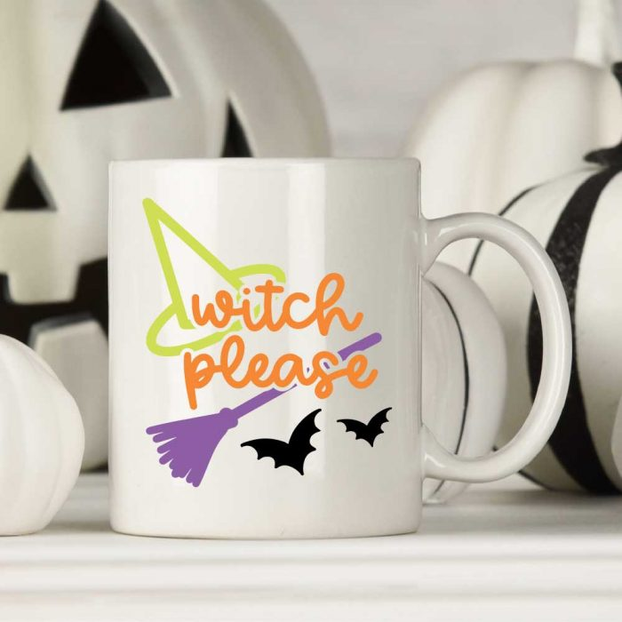 Halloween SVG on white mug with white pumpkins in background