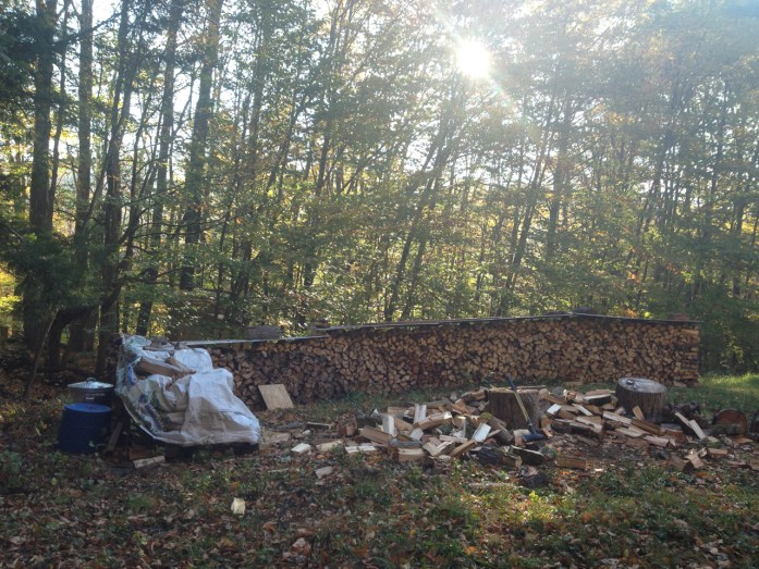 The woodpile is a mixture of ash, cherry, birch, and poplar. Homestead chores for winter