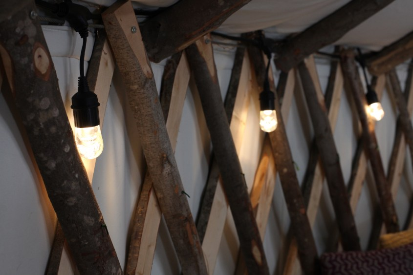 string of LED lights in off-grid yurt