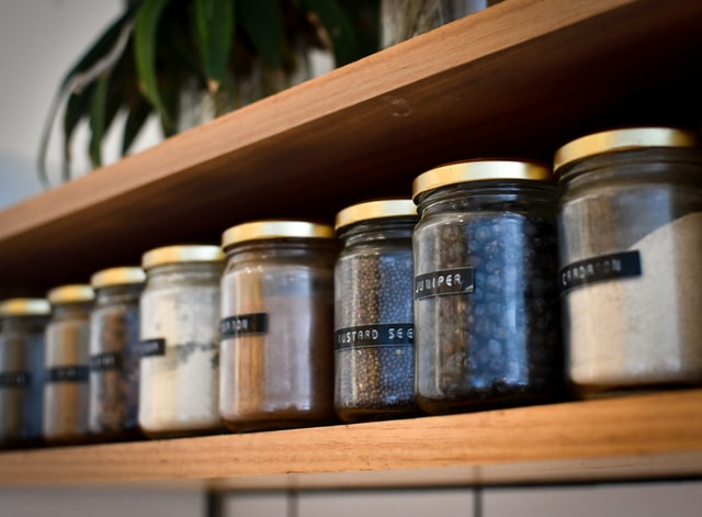 spice jars in a well-prepared pantry