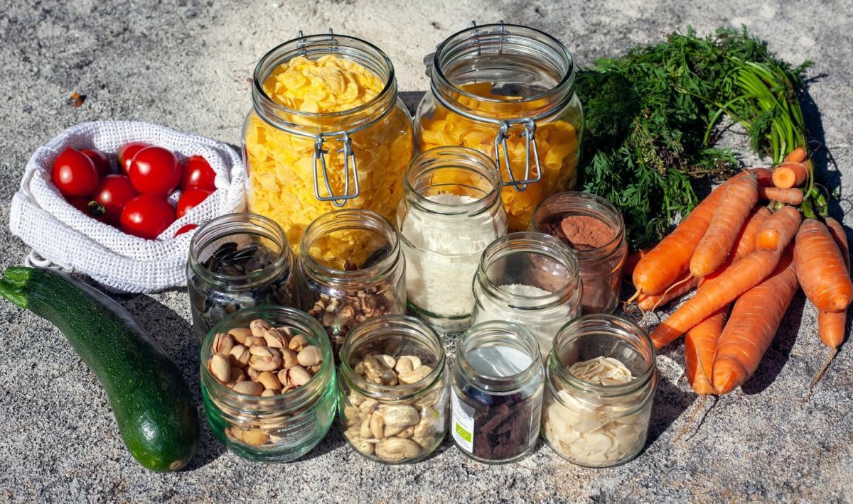 bulk foods in jars alongside vegetables