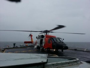 An MH-60 Jayhawk helicopter from Coast Guard Air Station Elizabeth City, N.C., is shown aboard the HMCS Halifax, a Royal Canadian Navy frigate, in the Atlantic Ocean approximately 30 miles east of Wachapreague, Va., Monday, April 7, 2014. The Jayhawk crew landed on the ship to medevac a crewmember experiencing abdominal pain.
