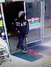An armed robber enters a convenience store in Mount Rainer, Md.