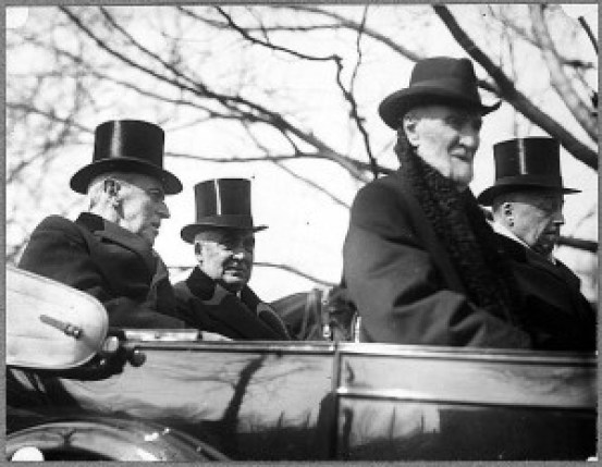 President Woodrow Wilson, left, rides with President-elect Warren Harding to the new president's inauguration. Wilson Bridge over the Potomac in Washington was named for Wilson when it opened for traffic in 1961. A new bridge replaced it in 2007.  Library of Congress