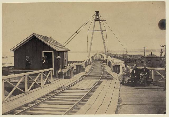 This view of the railroad bridge was taken about one-hundred and fifty years earlier and looks towards Washington DC from Alexandria, Va.