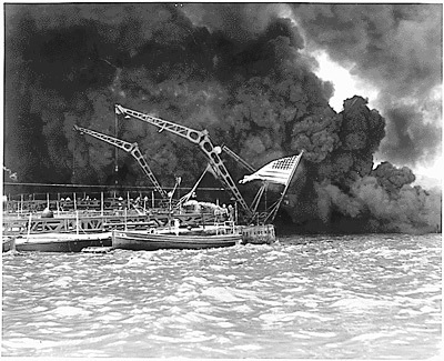 The flag still flies as the USS West Virginia sinks on battleship row at Pearl Harbor, Hawaii after a sneak attack by the Japanese on Dec. 7, 1941.