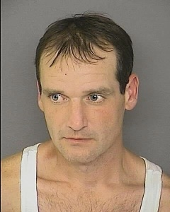 Martin Abell under arrest for theft of TV.