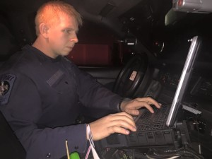 St. Mary's Sheriff Deputy Anthony Cole writing ticket on computer.
