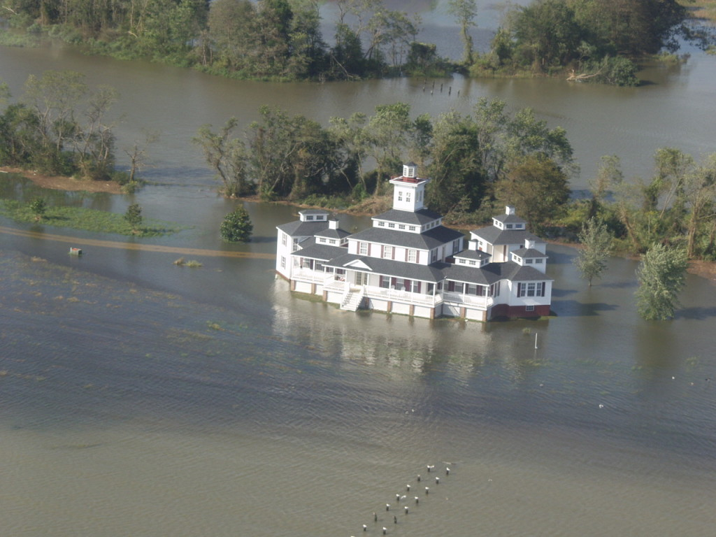 "The owner of this rambling riverfront home might want to name it ""River House"" with boat parking underneath."