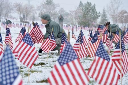 Airmen place flags in Utah Veterans Cemetery