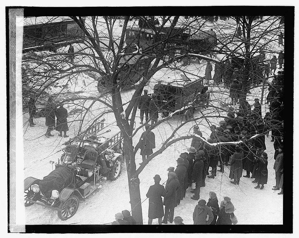 Firetrucks and ambulances at the Knickerbocker Theatre disaster in snowstorm of Jan 28, 1922