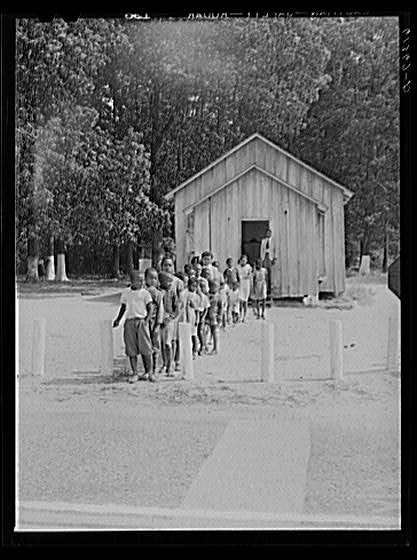 Children leaving St. Inigoes, Md., schoolhouse at lunch in the 1930's.
