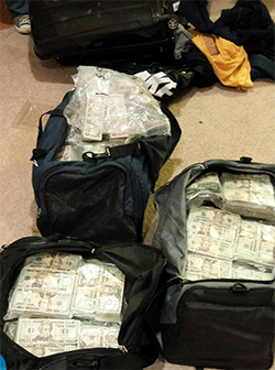 DEA Baltimore recovered three large duffel bags in the basement of E. Hernandez-Barba's home, the bags were found to contain $2.4 million.