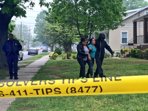 Loved ones near scene of murder of two men in District Heights Md. on May 11 2016. Photo courtesy of NBC 4 News