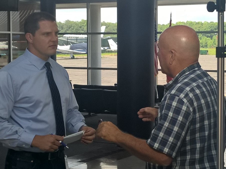 ABC 7 investigative reporter Chris Papst interviews former Commissioner Larry Jarboe inside the St. Mary's Regional Airport Terminal. THE CHESAPEAKE TODAY photo