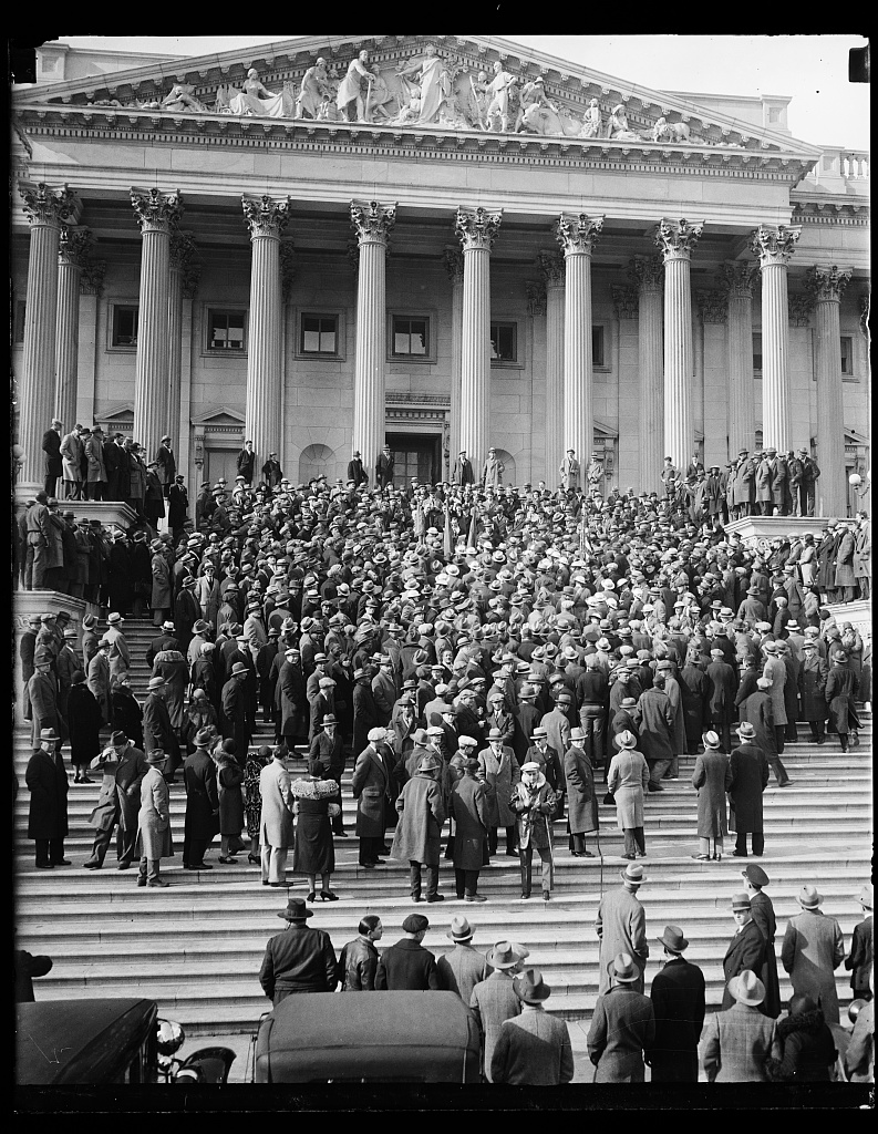 Bonus Army marches on Capitol. They were met on the Capitol steps by members of the House who are war veterans, where the photograph shows them being addressed by Rep. Wright Patman of Texas. Harris & E