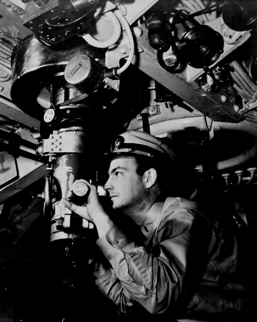 U. S. Naval Officer at periscope in control room of submarine. Ca. 1942. 80-G-11258.