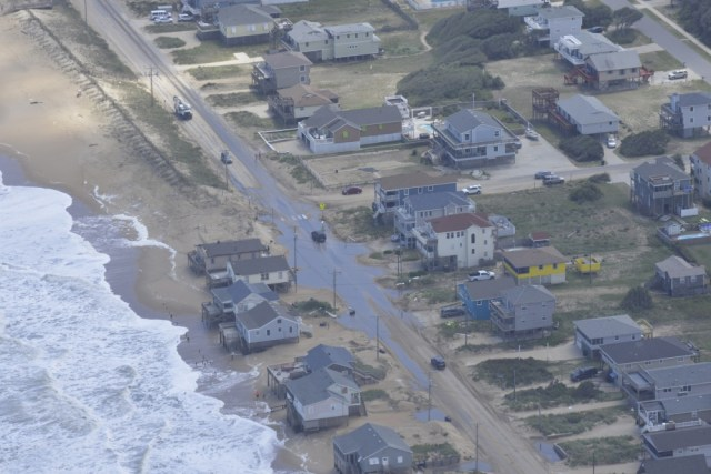 Drivers make their way down a flooded road on North Carolina's Outer Banks Sept. 4, 2016, caused by Tropical Storm Hermine September 2-3.  U.S. Coast Guard photo by Petty Of