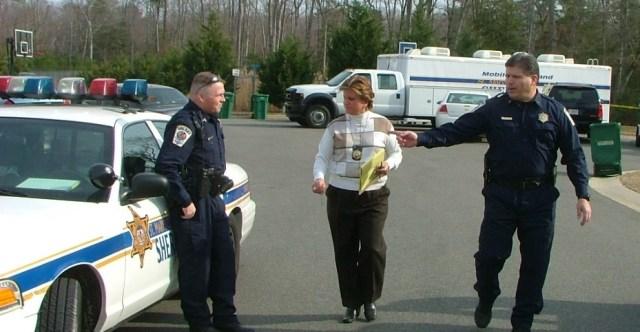 Sheriff-Tim-Cameron-right-and-PIO-Cindy-Allen-center-at-murder-scene.