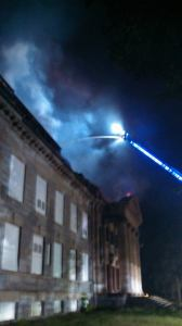 Water Witch VFC photo of aerial ladder fighting fire in Memorial Hall at Bainbridge NTC site.