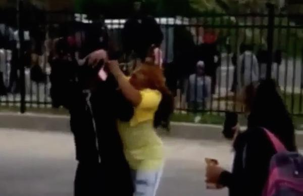 Mother slams her kid and drags him off the streets as riot starts in Baltimore