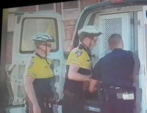 Freddie Gray being loaded into police paddy wagon