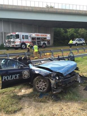 Anne Arundel police car turned into convertible after being hit by motorist. Anne Arundel County Fire Department photo