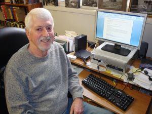 Gene Meyer at desk