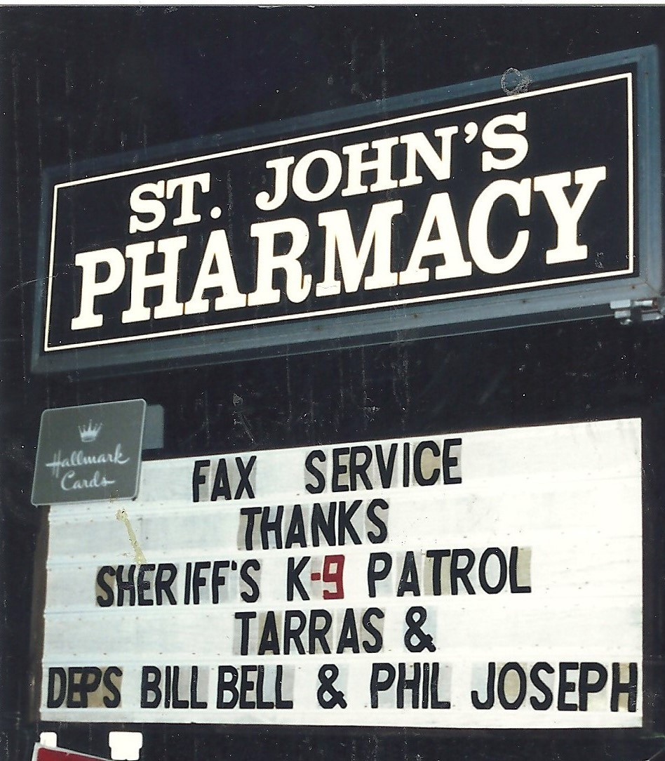 The gratitude of St. John's Pharmacy in Hollywood, Md., now a CVS, was expressed in this sign to Deputies Bell & Joseph along with famous K-9 Tarras.