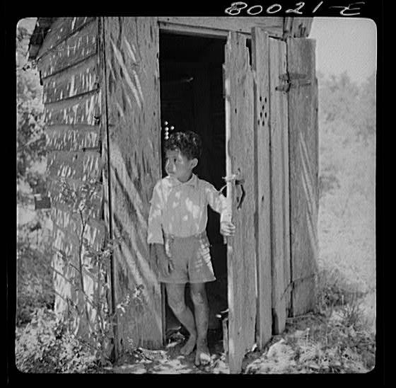 John Fredrick at outhouse in Ridge