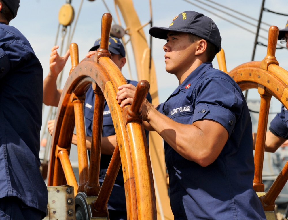 Coast Guard Eagle 3rd Class Andrew N. Ellis steers the ship on the Elizabeth River in Norfolk Va. Photo by PO 3rd Class Corinne Zilnicki