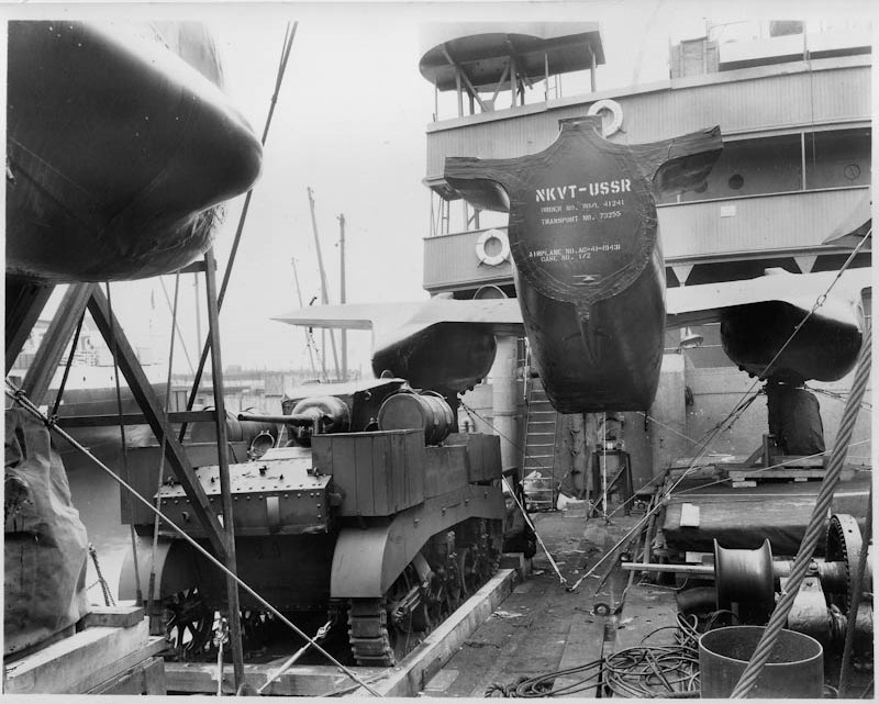 An M3A1 Stuart light tank and an A-20C Havoc attack aircraft serial number AC-41-19431 onboard a ship bound for the Soviet Union under the Lend Lease Program.