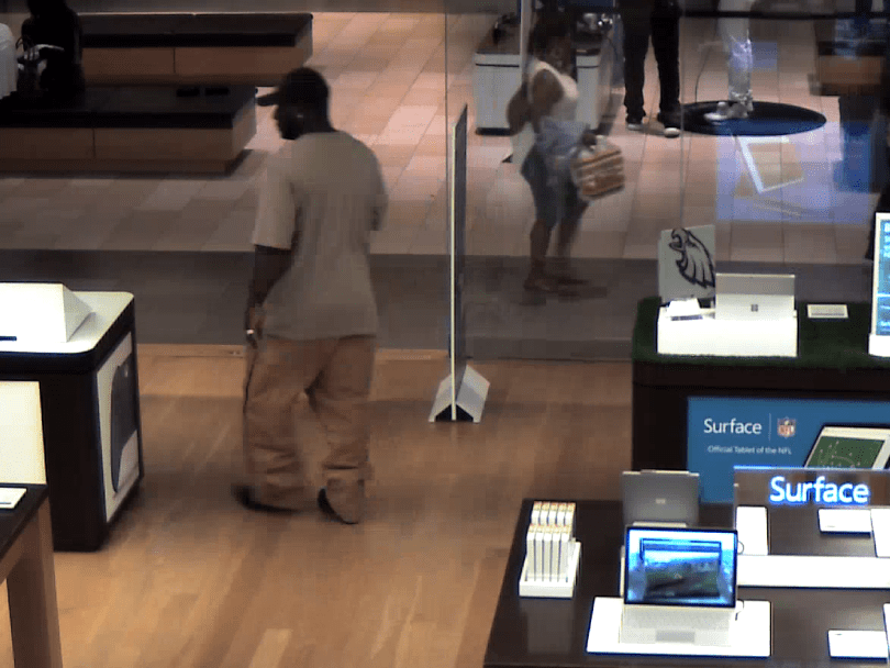 Shopping without paying is enough to wear a guy out, why didn't someone from Microsoft offer to carry out the loot for this chubby thief?
