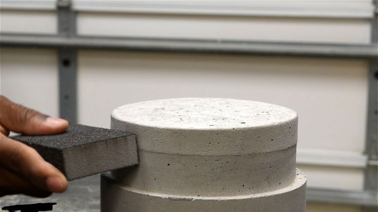 sanding the edges of the concrete