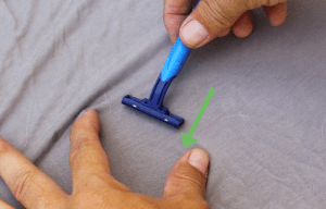 use a razor to pull pills from and old shirt