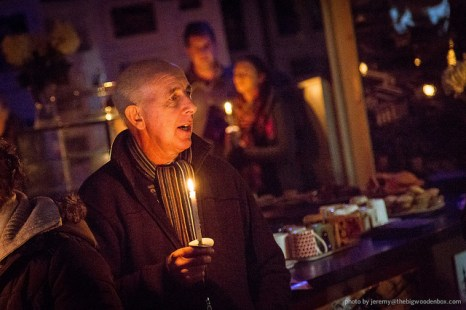 Singing carols by candlelight in The DOCK Cafe