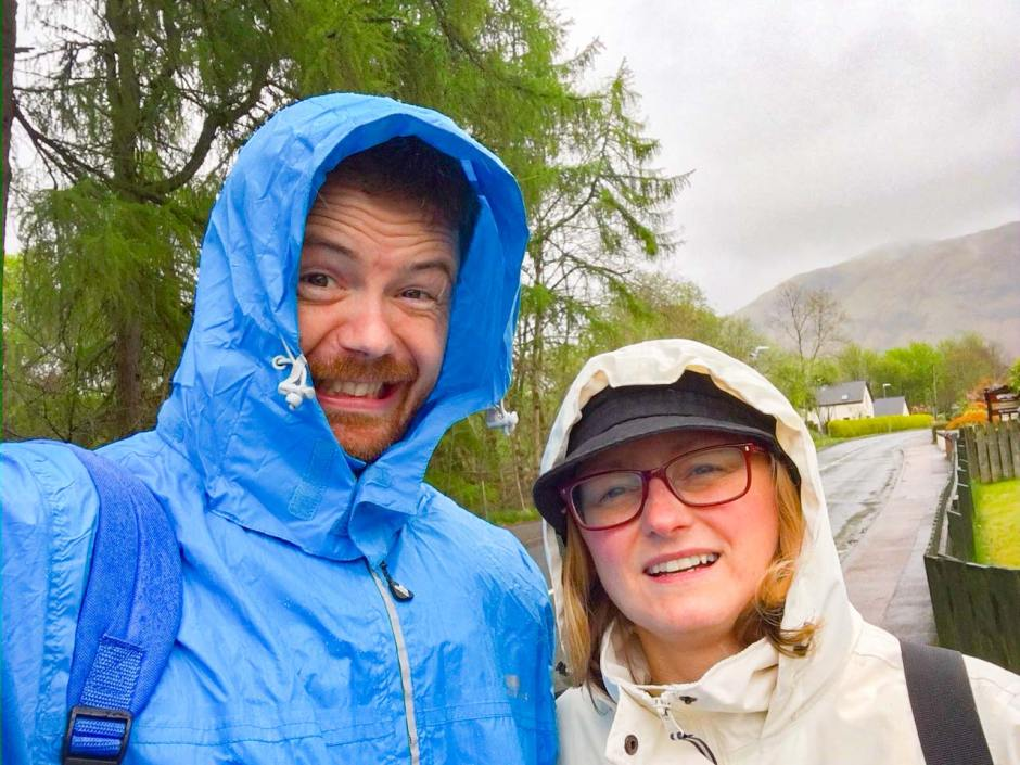 Chris and Susan in Scotland, wearing anoraks with hoods up, in the rain