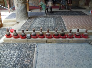Water is precious in Egypt.  These water jugs are placed in the mosque so that people can drink.