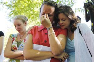 April Young Bennett, right, puts her arm around Heather Olson Beal during a prayer as Ordain Women hold a vigil in Salt Lake City Sunday, June 22, 2014. (Jeffrey D. Allred, Deseret News) (Kristy Money also pictured.)