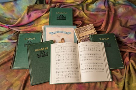 Pile of hymnbooks in different languages