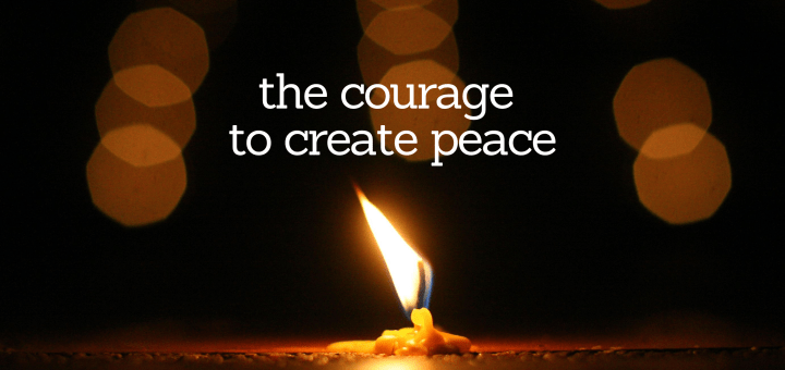"""Image of a candle burning in the darkness with the text """"the courage to create peace"""""""